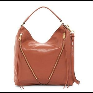 Rebecca Minkoff grained leather moto hobo bag.